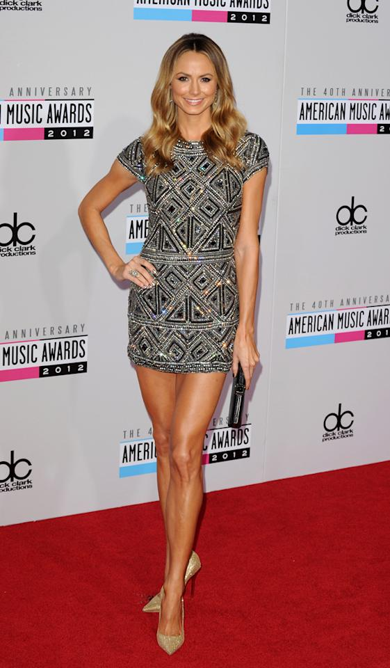 AMAs 2012: George Clooney's girlfriend looked effortlessly glamorous in this embellished cap sleeved mini dress teamed with heels and black clutch bag. Copyright [PA]