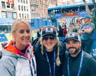 Edwards with Stock and John Lewensten, Johnsons business manager, at the 2019 Boston Marathon Lauren Edwards).