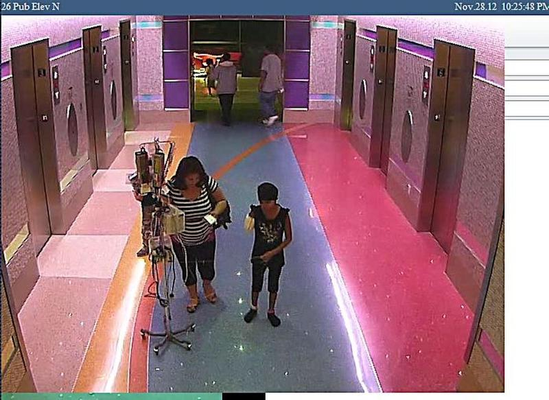 In this hospital surveillance photo released by the Phoenix Police Department on Monday, Dec. 3, 2012, a woman is seen with her 11-year-old daughter, a leukemia patient who had her arm amputated and a heart catheter inserted due to an infection. Authorities say the woman inexplicably took the girl from the hospital last week. Police say that if the catheter is left in too long it could lead to a deadly infection. The family's identity is being withheld but they are calling the girl Emily. (AP Photo/Phoenix Police Department)