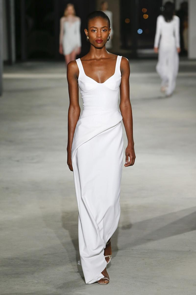 Image result for Cushnie et Ochs Carly Cushnie and Michelle Ochs celebrated 10 years in business with a collection done in a predominately neutral palette that could pass as bridal white. This sculpted bodice-cut number was a clear standout.
