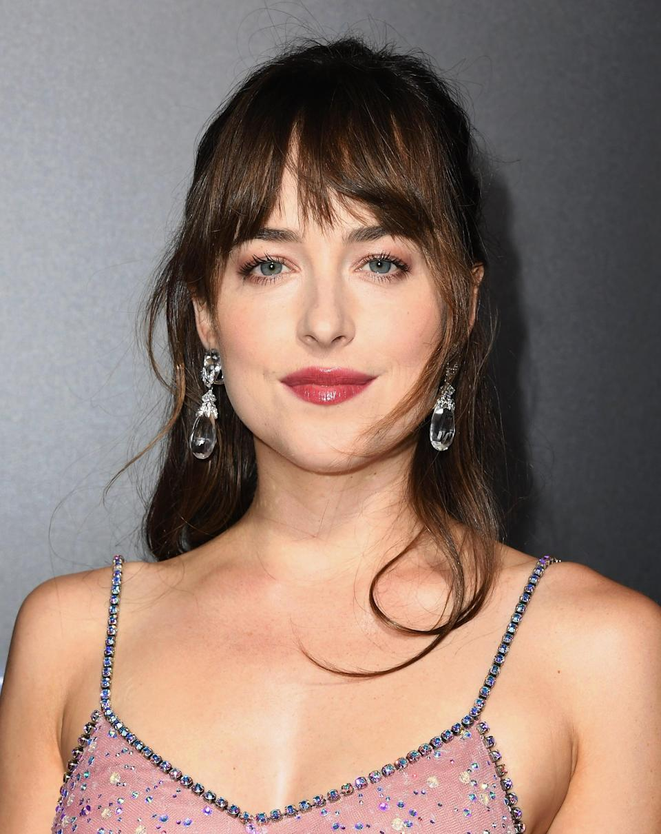 """<p>To say we're excited to see <a href=""""https://deadline.com/2021/04/dakota-johnson-set-to-star-in-netflix-mrc-films-jane-austen-update-persuasion-1234740184/"""" class=""""link rapid-noclick-resp"""" rel=""""nofollow noopener"""" target=""""_blank"""" data-ylk=""""slk:Johnson take on a modern Anne Elliot"""">Johnson take on a modern Anne Elliot</a> is an understatement. Despite still loving her fiancé, Frederick Wentworth, Anne is convinced at the age of 19 to break off the engagement. Eight years later, unmarried and facing bankruptcy, she reconnects with the love she thought she'd once lost. Now independent and confident in what she wants, Anne feels her future is up to her, not her family. </p> <p>Best known for her role as Anastasia Steele in the <a href=""""https://www.popsugar.com/Fifty-Shades-of-Grey"""" class=""""link rapid-noclick-resp"""" rel=""""nofollow noopener"""" target=""""_blank"""" data-ylk=""""slk:Fifty Shades of Grey"""">Fifty Shades of Grey</a> series, Johnson is no stranger to the romantic drama. We can't wait to see what she does in the role and with Cosmo Jarvis as the mysterious Captain Wentworth.</p>"""