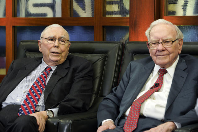 Berkshire Hathaway Chairman and CEO Warren Buffett, right, and his Vice Chairman Charlie Munger, left, speak during an interview in Omaha, Neb., Monday, May 7, 2018. (AP Photo/Nati Harnik)