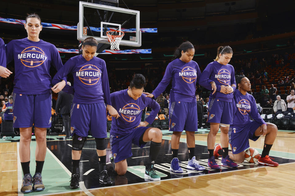 The Phoenix Mercury stand and kneel for the National Anthem before the game against the New York Liberty during Round Two of the 2016 WNBA Playoffs on September 24, 2016 at Madison Square Garden in New York City, New York. (Photo by David Dow/NBAE via Getty Images)