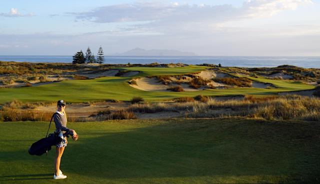 """<div class=""""caption""""> There I am, enjoying the beauty that is the par-3 17th </div>"""