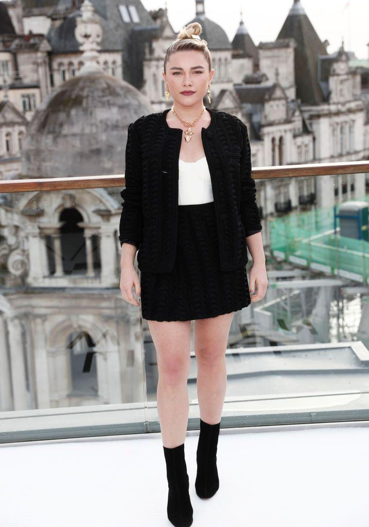 <p>Pugh wore a black skirt suit to a morning photocall for Little Women at the Corinthia Hotel London, December 2019.</p>