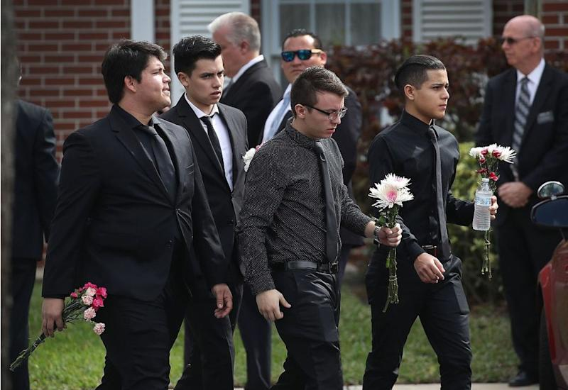 Mourners dressed in black for Alaina Petty's funeral