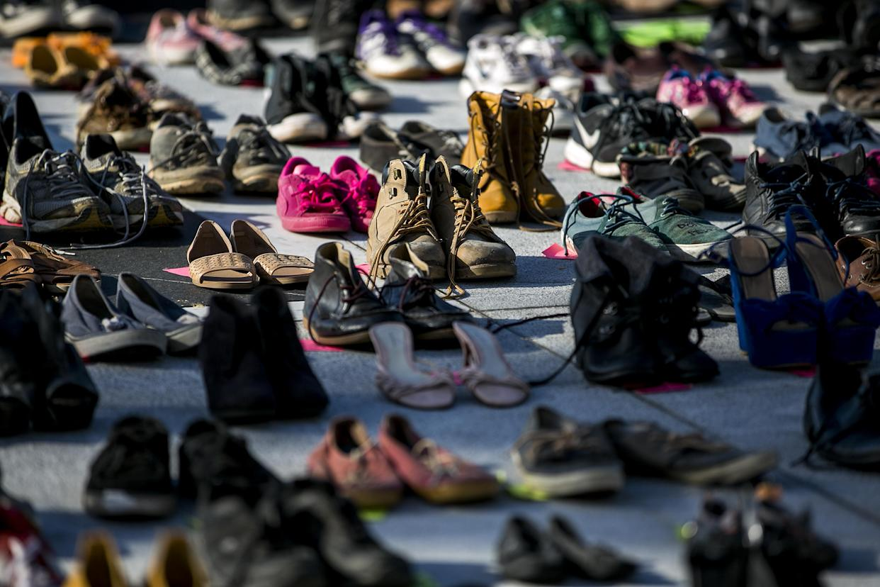 Empty pairs of shoes sit outside the Capitol building in San Juan, Puerto Rico, during a June 1 protest against the government's reporting of the death toll from Hurricane Maria. (Photo: Xavier Garcia/Bloomberg via Getty Images)