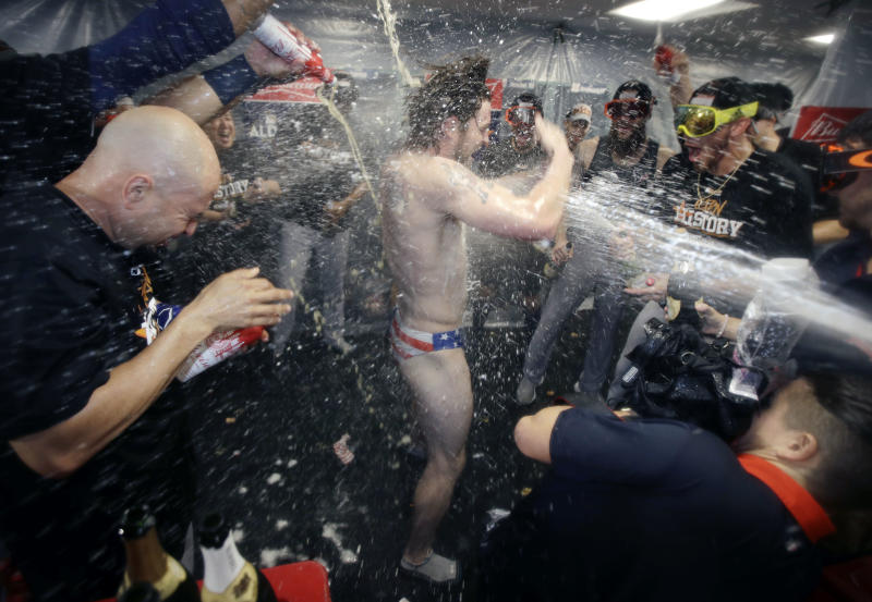 Houston Astros' Josh Reddick is sprayed in the clubhouse after the Astros defeated the Boston Red Sox 5-4 in Game 4 of the ALDS. (AP)