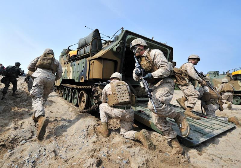 US Marines get out from an amphibious assault vehicle during a joint military exercise with their South Korean counterparts at Pohang, on March 31, 2014 (AFP Photo/Jung Yeon-Je)