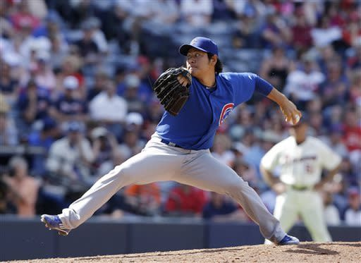Chicago Cubs relief pitcher Hisanori Takahashi works in he eighth inning of a baseball game against the Atlanta Braves in Atlanta, Sunday, April 7, 2013. Atlanta won 5-1. (AP Photo/John Bazemore)