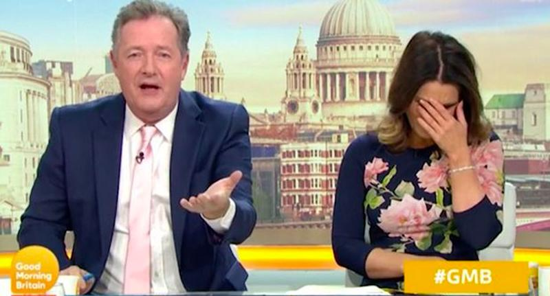 Pictured is Piers Morgan and Susanna Reid, who has her hand to her face, in the Good Morning Britain studio