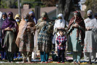 Muslim women perform an Eid al-Fitr prayer in an outdoor open area, marking the end of the fasting month of Ramadan, Thursday, May 13, 2021 in Morton Grove, Ill. (AP Photo/Shafkat Anowar)