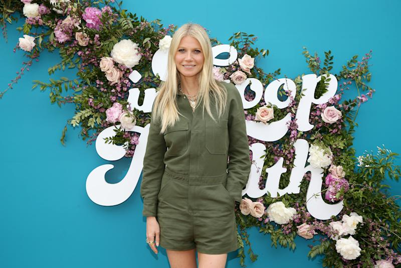 Gwyneth Paltrow looks chic in this green low-cut jumpsuit, that shows off her slender legs