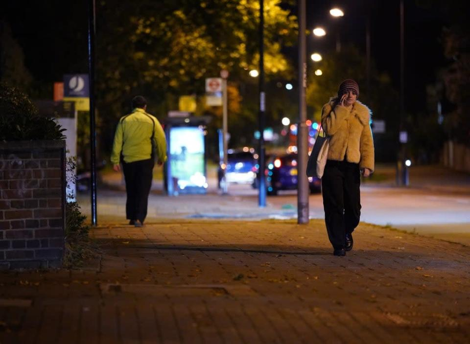 A woman walking after dark on Poynders Road in Clapham, south London, close to where Sarah Everard was abducted in March (Yui Mok/PA) (PA Wire)