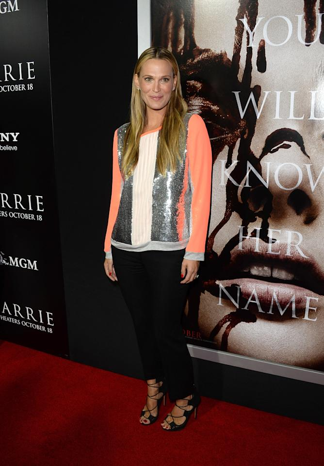 "HOLLYWOOD, CA - OCTOBER 07: Model/actress Molly Sims arrives at the premiere of Metro-Goldwyn-Mayer Pictures & Screen Gems' ""Carrie"" at ArcLight Cinemas on October 7, 2013 in Hollywood, California. (Photo by Jason Merritt/Getty Images)"