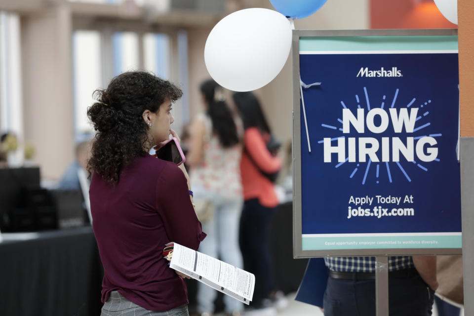 FILE - In this Oct. 1, 2019, file photo, Daisy Ronco waits in line to apply for a job with Marshalls during a job fair at Dolphin Mall in Miami. On Wednesday, Oct. 30, payroll processor ADP reports on how many jobs its survey estimates U.S. companies added in October. (AP Photo/Lynne Sladky, File)