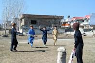 Children play cricket at the site Osama bin Laden's demolished former compound