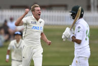 New Zealand bowler Kyle Jamieson celebrates the wicket of Pakistan's Shan Masood, right, during play on day two of the first cricket test between Pakistan and New Zealand at Bay Oval, Mount Maunganui, New Zealand, Sunday, Dec. 27, 2020. (Andrew Cornaga/Photosport via AP)