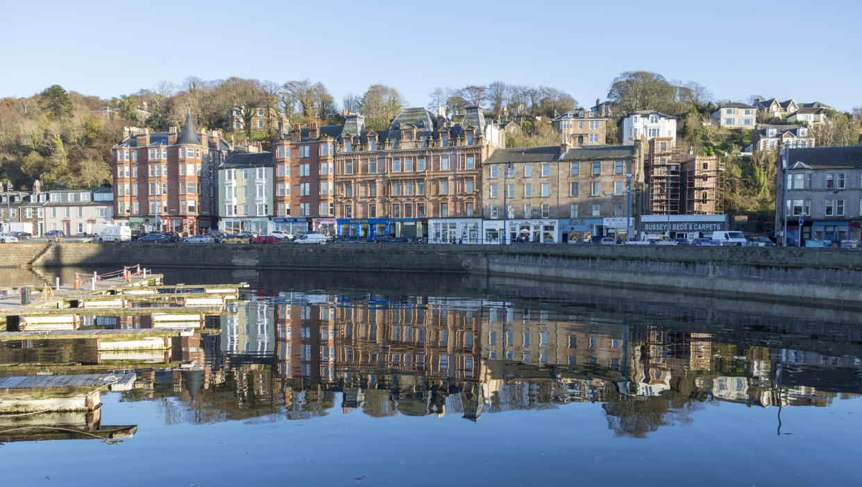 Buildings at Rothesay port reflected in clear water (Getty Images)