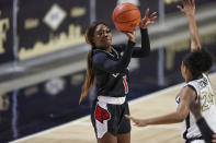 Louisville guard Dana Evans (1) shoots over Wake Forest guard Jewel Spear (24) in the first quarter of an NCAA women's college basketball game in Winston-Salem, N.C., Sunday, Jan. 24, 2021. (AP Photo/Nell Redmond)