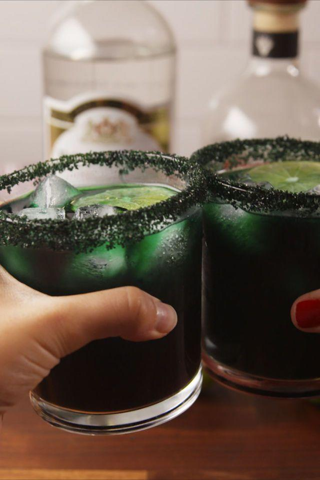 """<p>Green food coloring makes this silver tequila and triple sec margarita extra spooky. You can also use red or blue for a different color effect.</p><p><em>Get the recipe from <a href=""""https://www.delish.com/cooking/recipe-ideas/recipes/a55953/black-magic-margaritas-recipe/"""" rel=""""nofollow noopener"""" target=""""_blank"""" data-ylk=""""slk:Delish"""" class=""""link rapid-noclick-resp"""">Delish</a>.</em> </p>"""