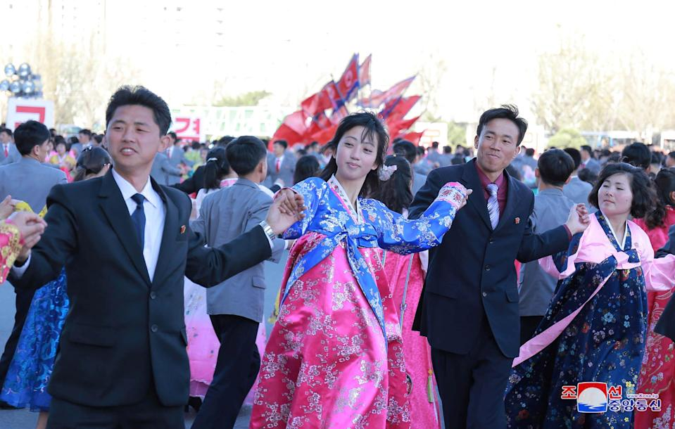 <p>Dancing parties of youth and students are seen during a celebration of the 6th anniversary of Kim Jong Un's assumption of the top posts of the party and the state, in this undated photo released by North Korea's Korean Central News Agency (KCNA) in Pyongyang April 11, 2018. REUTERS/KCNA ATTENTION EDITORS – THIS PICTURE WAS PROVIDED BY A THIRD PARTY. REUTERS IS UNABLE TO INDEPENDENTLY VERIFY THE AUTHENTICITY, CONTENT, LOCATION OR DATE OF THIS IMAGE. NO THIRD PARTY SALES. NOT FOR USE BY REUTERS THIRD PARTY DISTRIBUTORS. SOUTH KOREA OUT. NO COMMERCIAL OR EDITORIAL SALES IN SOUTH KOREA </p>