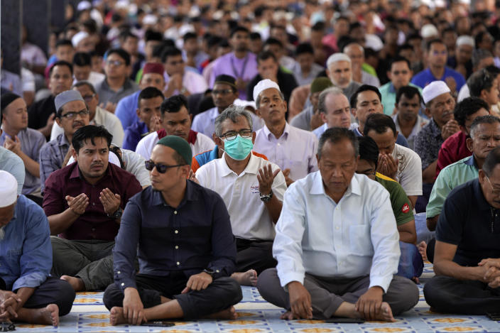 Malaysian Muslims attend Friday prayers at the National Mosque in Kuala Lumpur, Malaysia, Friday, Feb. 28, 2020. The speaker of Malaysia's House rejected interim leader Mahathir Mohamad's call for a vote next week to chose a new premier, deepening the country's political turmoil after the ruling alliance collapsed this week. (AP Photo/Vincent Thian)