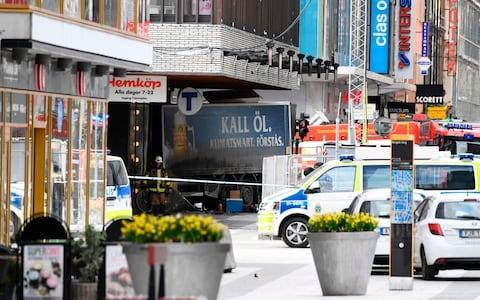 <span>The lorry used in the terror attack in Stockholm</span> <span>Credit: JONATHAN NACKSTRAND/AFP </span>