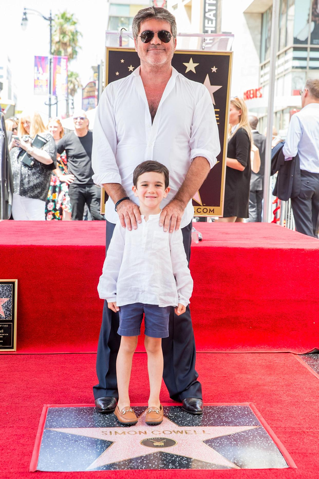 Simon Cowell and son Eric at a ceremony honoring Cowell with a star on the Hollywood Walk of Fame on Aug. 22, 2018. (Photo: Rich Fury/Getty Images)