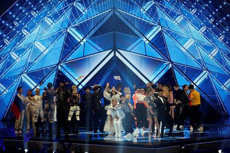 Performers from countries that qualified to the final of the 2019 Eurovision Song Contest gather on stage at the end of the first semi final session in Tel Aviv, Israel May 15, 2019. REUTERS/Ronen Zvulun