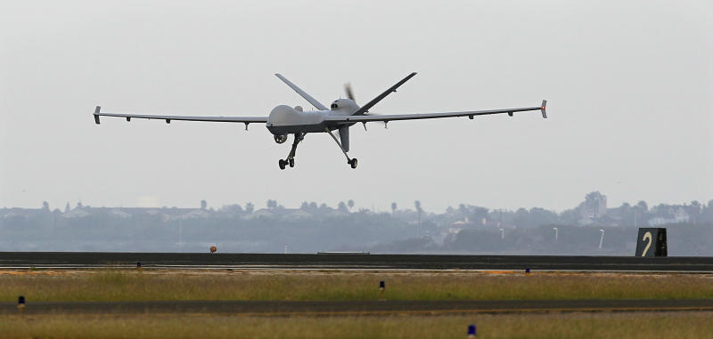 FILE - This Nov. 8, 2011 file photo shows a Predator B unmanned aircraft landing after a mission, at the Naval Air Station, in Corpus Christi, Texas. At the Air Force Academy in Colorado Springs, becoming a fighter pilot is still a hotly coveted goal. But slowly, a culture change is taking hold. Initially snubbed as second-class pilot-wannabes, the airmen that remotely control America's arsenal of lethal drones are gaining stature and securing a permanent place in the Air Force. (AP Photo/Eric Gay, File)