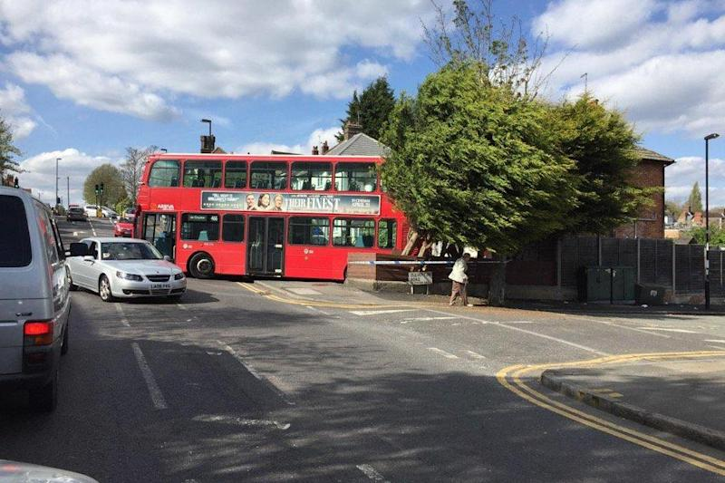 The bus appeared to crash into a front garden in Croydon on Saturday afternoon: Simon Hutton