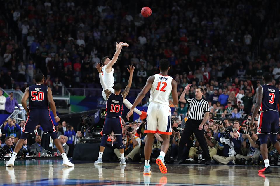 Kyle Guy #5 of the Virginia Cavaliers attempts a three point basket as he is defended by Samir Doughty #10 of the Auburn Tigers in the second half during the 2019 NCAA Final Four semifinal at U.S. Bank Stadium on April 6, 2019 in Minneapolis, Minnesota. (Photo by Tom Pennington/Getty Images)