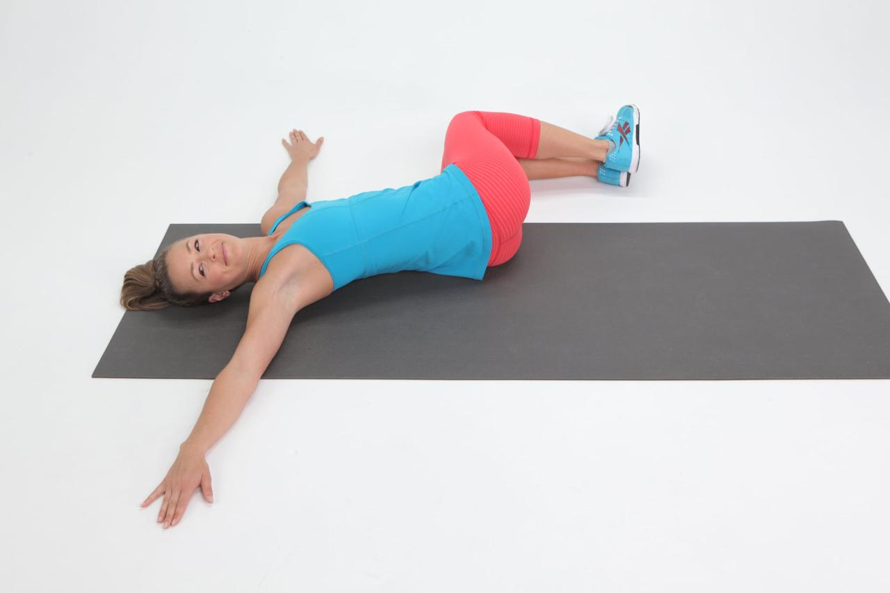 "<p>Targeting your back and hips, this move is great for pain caused by a <a href=""https://www.popsugar.com/fitness/Best-Exercises-Weak-Core-46495708"" class=""ga-track"" data-ga-category=""Related"" data-ga-label=""http://www.popsugar.com/fitness/Best-Exercises-Weak-Core-46495708"" data-ga-action=""In-Line Links"">weak core</a> or tight muscles as a result of too much sitting or running without proper stretching.</p> <ul> <li>Start on your back with your hands on the floor to the side of your body.</li> <li>Drop your knees to the left side of your body while turning your head to the right. </li> <li>Hold this stretch for 30 seconds then switch to the other side. Repeat two sets of 30-second reps every day or after your workout.</li> </ul>"