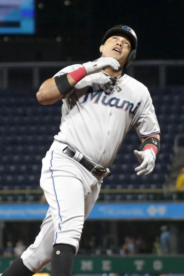 Miami Marlins' Starlin Castro, looks up as rounds the bases after hitting a two-run home run against the Pittsburgh Pirates during the fifth inning of a baseball game Wednesday, Sept. 4, 2019, in Pittsburgh. (AP Photo/Keith Srakocic)