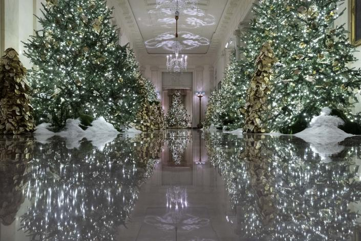 The Cross Hall leading into the State Dinning Room is decorated during the 2019 Christmas preview at the White House, Monday, Dec. 2, 2019, in Washington. | AP—Copyright 2019 The Associated Press. All rights reserved.