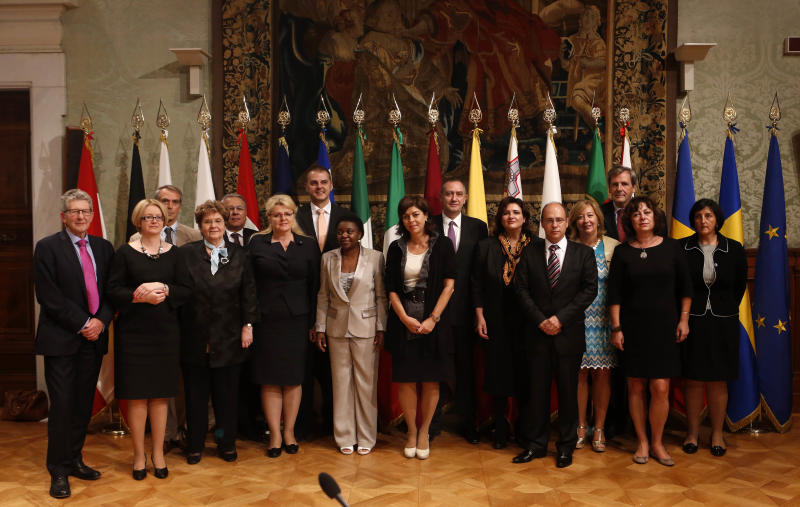 """Participants of the European Integration Ministers Meeting pose for a family photo at Chigi Palace government office in Rome, Monday, Sept. 23, 2013. Cabinet ministers from more than a dozen European nations have come to Rome in a show of support for Italy's first black cabinet minister who has been attacked with racist taunts ever since she was appointed in April. The ministers signed a declaration Monday condemning racism as anathema to Europe's democratic principles. They said the attacks that Cecile Kyenge has been subjected to were unacceptable and must stop, particularly since they have come from politicians. Members of Italy's xenophobic Northern League party have called the Congolese-born Kyenge """"Congolese monkey"""" and other epithets. Belgium's deputy prime minister Joelle Milquet sponsored the initiative. (AP Photo/Riccardo De Luca)"""