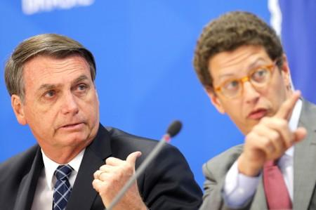 Brazil's President Jair Bolsonaro and Brazil's Environment Minister Ricardo Salles attend a news conference at the Planalto Palace in Brasilia