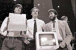 Steve Jobs and others from Apple, 1984. Credit: AP