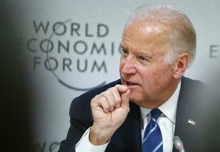 """U.S. Vice President Joe Biden addresses the session """"Cancer Moonshot: A Call to Action"""" during the annual meeting of the World Economic Forum (WEF) in Davos, Switzerland January 19, 2016. REUTERS/Ruben Sprich"""