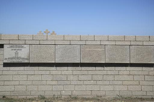 In this Sunday, June 17, 2018 photo, the names of the Nazi German soldiers who died in the World War II battle of Stalingrad are written on the Memorial cemetery near Volgograd, Russia. Nearly 60 years since it changed its name to Volgograd, the Russian city once called Stalingrad and its bloody history loom large even in the midst of the fun and football of the World Cup. (AP Photo/Thanassis Stavrakis)