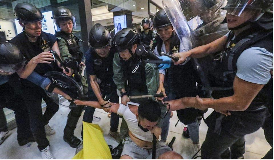 Anti-government protesters and police officers clash at New Town Plaza in Sha Tin on July 14, 2019. Photo: Felix Wong