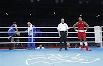 JUDGES UNDER FIRE: Iran's Ali Mazaheri (L) leaves the ring before the decision after being disqualified during his Men's Heavy (91kg) Round of 16 boxing match against Jose Larduet Gomez (R) of Cuba at the London 2012 Olympic Games August 1, 2012.