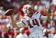 <p>Trending down: Mike White, Western Kentucky — Can White put up video game-like statistics for a second-straight season? White completed more than two-thirds of his passes in 2016 and threw for over 4,300 yards. But WKU returns just three other offensive starters and coach Brian Brohm and his offensive system are now at Purdue. (Photo credit: AP) </p>