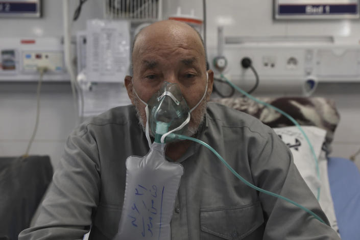 Afghan citizen Zamen Mousavi, a Covid-19 patient breathes with oxygen mask at the COVID-19 ICU ward of Amir Al-Momenin hospital in the city of Qom, some 80 miles (125 kilometers) south of the capital Tehran, Iran, Wednesday, Sept. 15, 2021. (AP Photo/Vahid Salemi)
