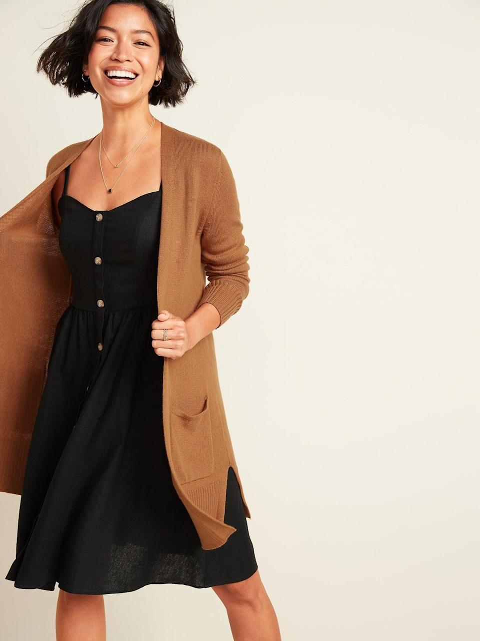 """<p>""""As the chilly weather takes over, I've been looking for the perfect layer to make my fall outfit feel cozy and cute, and this 'warm coffee' <span>Old Navy Long-Line Open-Front Cardigan</span> ($35, originally $40) absolutely fits the bill. It's light, soft, and can easily be thrown over a t-shirt and a pair of jeans any day of the week."""" - Chanel Vargas, editorial assistant, Trending & Viral Features</p>"""