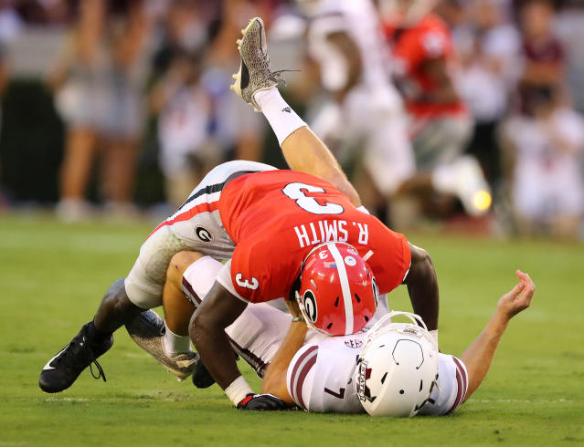 FILE - In this Sept. 23, 2017, file photo, Georgia linebacker Roquan Smith levels Mississippi State quarterback Nick Fitzgerald who just gets the ball off for a incomplete pass during the first half of an NCAA college football game in Athens, Ga. Roquan Smith is a possible first round pick in the NFL Draft. (Curtis Compton/Atlanta Journal Constitution via AP, File)