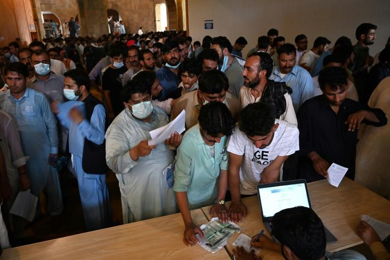Hundreds of Pakistanis overwhelmed a coronavirus vaccination centre as the nation grapples with a shortage of shots