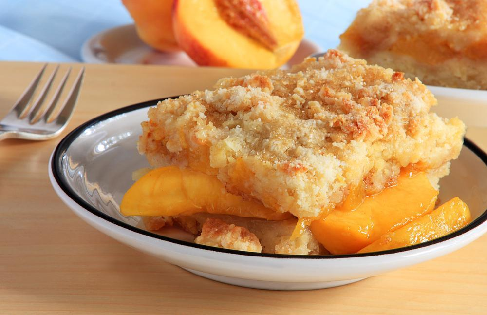 """<p>Peach cobbler is one of the most <a href=""""https://www.thedailymeal.com/cook/southern-recipes-to-try?referrer=yahoo&category=beauty_food&include_utm=1&utm_medium=referral&utm_source=yahoo&utm_campaign=feed"""">iconic Southern dishes that everyone in America needs to try</a>, and while fresh peaches are ideal, you can swap them for frozen peaches so you can enjoy this dessert any time of year.</p> <p><a href=""""https://www.thedailymeal.com/recipes/old-fashioned-peach-cobbler?referrer=yahoo&category=beauty_food&include_utm=1&utm_medium=referral&utm_source=yahoo&utm_campaign=feed"""">For the Old-Fashioned Peach Cobbler recipe, click here.</a></p>"""