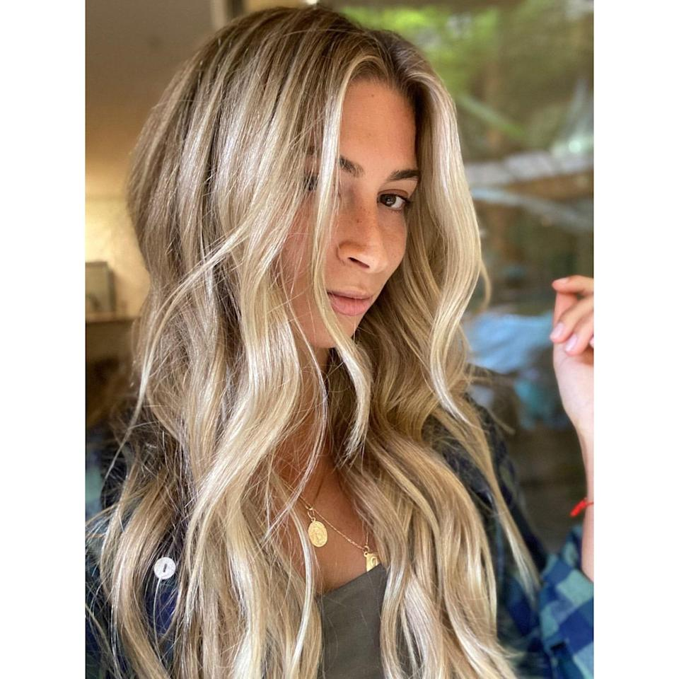 """To refresh your blonde hair, you can use a <a href=""""https://www.allure.com/gallery/best-purple-shampoo-conditioner-blonde-hair?mbid=synd_yahoo_rss"""" rel=""""nofollow noopener"""" target=""""_blank"""" data-ylk=""""slk:purple shampoo"""" class=""""link rapid-noclick-resp"""">purple shampoo</a> or conditioner. You can also give yourself a clear gloss. We love <a href=""""https://www.kristinesshair.com/in-shower-gloss"""" rel=""""nofollow noopener"""" target=""""_blank"""" data-ylk=""""slk:Kristin Ess's In-Shower Signature Glosses"""" class=""""link rapid-noclick-resp"""">Kristin Ess's In-Shower Signature Glosses</a> — she has four options for blondes, plus a clear one for those who aren't looking for any added color."""